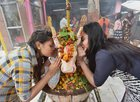 Girls offer prayers at a Shiva temple in Patna on the occasion of Mahashivratri on Tuesday. PTI