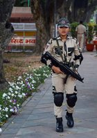 A woman commando of Delhi Police on duty outside Parliament in New Delhi on the eve of Women's Day. PTI