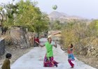 Lahari (14) tosses a volleyball in the air, as her sister Nirmala (10) tries to catch it, at village Kelu Khadra in Udaipur. An NGO, Vikalp Sansthan, is training girls of this Bhil tribe in volleyball; in an attempt to try and pull them out of their homes and making them comfortable not just in the open fields of the village area but also with their own selves. PTI