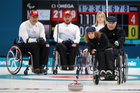 Daria Shchukina, Paralympic athlete from Russia, delivers a stone during Wheelchair Curling. Reuters