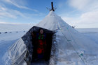 A woman from the indigenous community 'Yamb To' (Long Lake) looks out a tent at a reindeer camping ground, about 450 km northeast of Naryan-Mar, in Nenets Autonomous District, Russia, March 1. Reuters