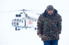 A herder of the agricultural cooperative organisation 'Erv' walks in front of a helicopter at a reindeer camping ground, about 250 km north of Naryan-Mar, in Nenets Autonomous District, Russia, March 8. Reuters