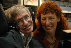 British astrophysicist Professor Stephen Hawking and his wife Elaine (R) visit the stand of German bookseller Rowohlt at the Frankfurt book fair, on October 19, 2005. Reuters