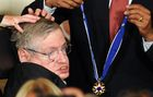 In this file photo taken on August 12, 2009, Stephen Hawking receives the Presidential Medal of Freedom from US President Barack Obama during a ceremony in the East Room at the White House on August 12, 2009. AFP