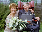 Stephen Hawking and his new bride Elaine Mason pose for pictures after the blessing of their wedding at St. Barnabus Church September 16, 1995. Reuters