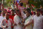 Samajwadi Party workers celebrate results outside a counting centre during counting in the Phulpur Lok Sabha seat by-election in Allahabad on March 14, 2018. AFP photo