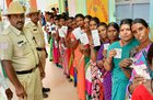 Voters stand in queue with their voting ID at a polling booth during the Karnataka Assembly elections, at Hundi village in Mysore on May 12. PTI