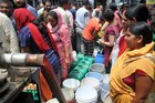 Residents wait to collect drinking water at Kusumpati in Shimla on May 31, 2018. Tribune photo Amit Kanwar