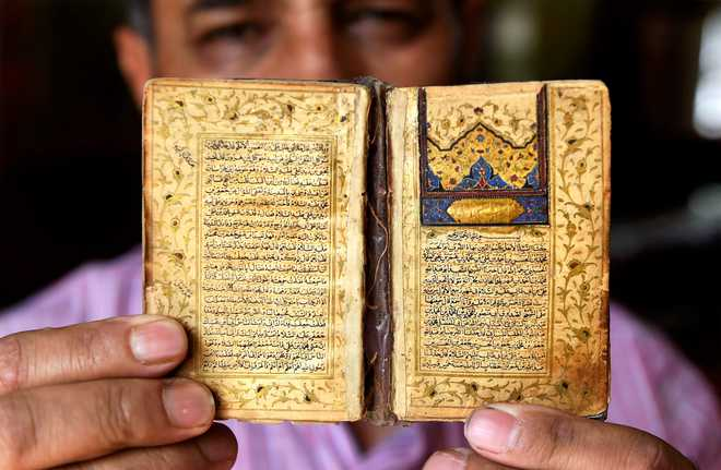Now showing in Srinagar: Hindu family's collection of rare Islamic manuscripts