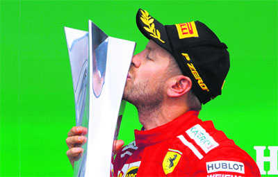 Vettel takes 50th victory and lead