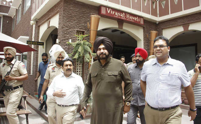 Sidhu suspends 8 MC officials for allowing illegal construction