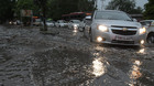 Cars move on a water-logged road after heavy rain at Sector 17 in Chandigarh on Friday. Tribune photo: Ravi Kumar