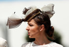A racegoer attends the second day of the Epsom Derby Festival in Surrey, southern England, on June 2. Via Reuters