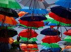 A worker in a cherry picker truck arranges coloured umbrellas hanging over a street in preparation for a music festival at the weekend, in Zabbar, Malta, on June 5, 2018. Reuters