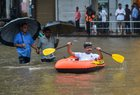A man rides a rubber boat on a flooded street during heavy rain showers in Mumbai on June 9, 2018. PTI photo