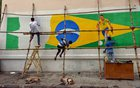 A painter applies finishing touches to an image of soccer player Neymar, on a large Brazilian flag on a road side wall ahead of the FIFA World Cup, in Kolkata, June 9. Reuters