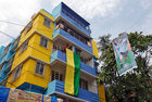 Fans hang a large flag from a residential building next to a banner featuring Argentina's player Lionel Messi ahead of the FIFA World Cup, in Kolkata, June 10. Reuters