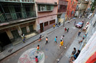 Boys play soccer barefoot in a residential area in Kolkata. Reuters