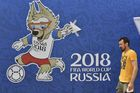 A man passes a poster featuring Zabivaka, the official mascot of the Russia 2018 World Cup football tournament, outside the 80,000-seater Luzhniki Stadium in Moscow on June 12, 2018. AFP photo