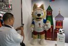 A man takes photos on a Zabivaka, the official mascot of 2018 Football World Cup, at a Hisense stand as the company sponsors the 2018 Football World Cup, during the Consumer Electronics Show (CES) Asia in Shanghai on June 13, 2018. AFP photo