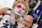 A Japan fan with the national flag painted on his face and ideograms on the chest looks on as he waits before the Russia 2018 World Cup Group H football match between Japan and Poland at the Volgograd Arena in Volgograd on June 28. AFP