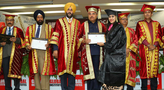 897 students conferred with degrees at Global Institutes