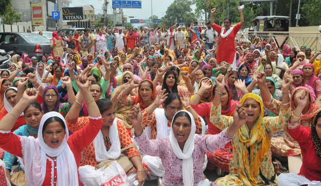 Anganwadi workers seek hike in salary, stage protest