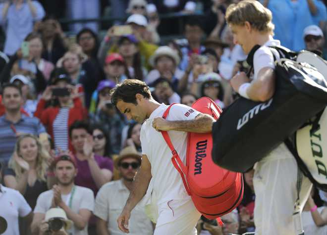 Federer suffers shock Wimbledon quarter-final loss to Anderson
