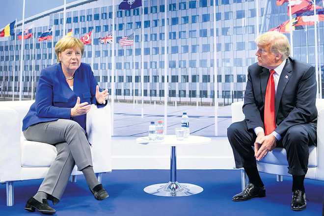 Trump, Merkel clash at NATO summit