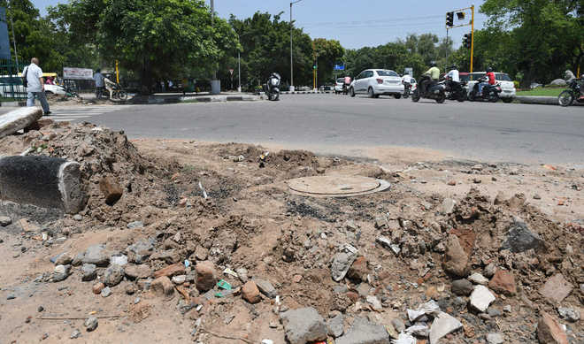 Road repair work on hold, courtesy fund crunch