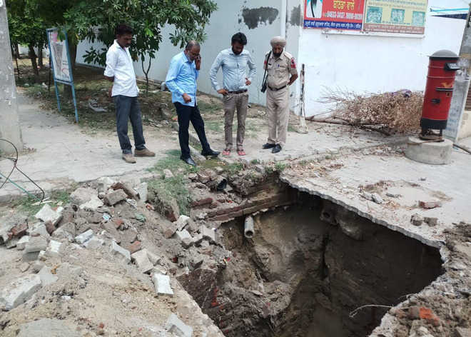 Earth around sewer line caves in at Model Town