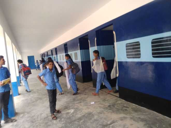 School painted like train to draw students