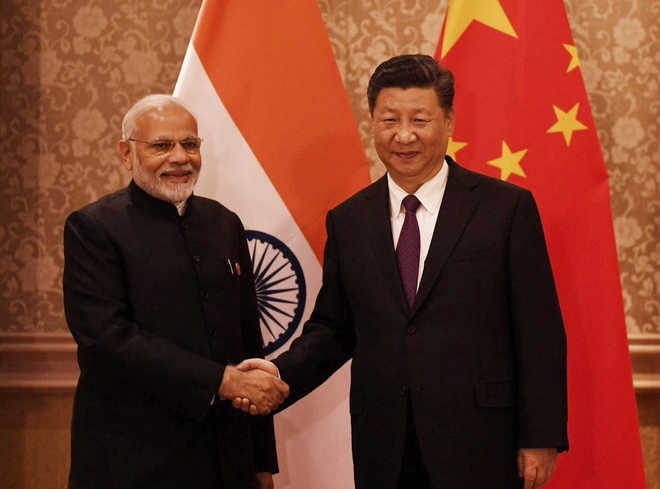 PM Modi, President Xi agree to maintain 'momentum' in ties..
