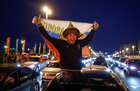 A Russian supporter celebrates the victory. Reuters