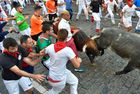 Participants run next to Cebada Gago fighting bulls on the third day of the San Fermin bull run festival in Pamplona, northern Spain, on July 9, 2018. AFP photo