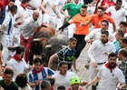Participants run next to Cebada Gago fighting bulls on the third day of the San Fermin bull run festival in Pamplona, northern Spain on July 9, 2018. AFP photo
