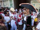 A Cabezudo (Large Head Puppets) jokes with a child during the parade of 'Gigantes and Cabezudos' (Giants and Large Head Puppets) on the second day of the San Fermin bull run festival in Pamplona, northern Spain on July 8, 2018. AFP photo