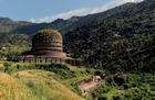 This photo taken on April 27, 2018, shows Pakistani visitors walking past a centuries-old stupa, a dome-shaped Buddhist monument, in the town of Amluk Dara near Mingora, the capital of the northwestern Swat Valley of Pakistan. The Buddha of Swat, carved on a cliff in the seventh century, was dynamited by the Pakistani Taliban in 2007. Now it has been restored, a powerful symbol of tolerance in the traumatised Pakistani valley. AFP photo