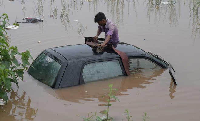 Dhakoli woman rescued as car falls into pond
