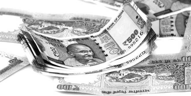 Comfortable forex reserves to deal with undue Re volatility: Jaitley