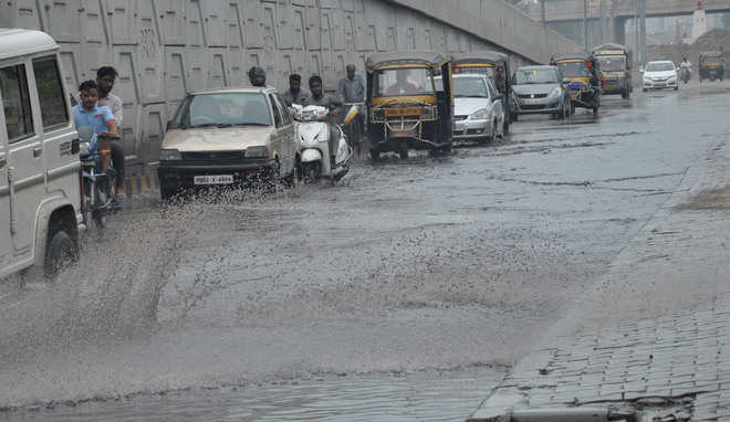 Commuters troubled as road flooded with sewage