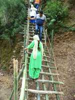 Bamboo stairs the only way to reach village