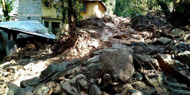 Muck flows down from hill, damages houses