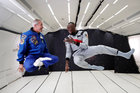 Retired sprinter Usain Bolt poses with staff members holding a bottle of 'Mumm Grand Cordon Stellar' champagne after they enjoy zero gravity conditions during a flight in a specially modified Airbus Zero-G plane above Reims, France. Reuters