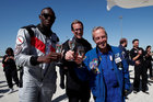 Retired sprinter Usain Bolt, French astronaut Jean-Francois Clervoy, CEO of Novespace, and Quentin Meurisse after they enjoyed zero gravity conditions during a flight in a specially modified Airbus Zero-G plane above Reims, France, September 12. Reuters