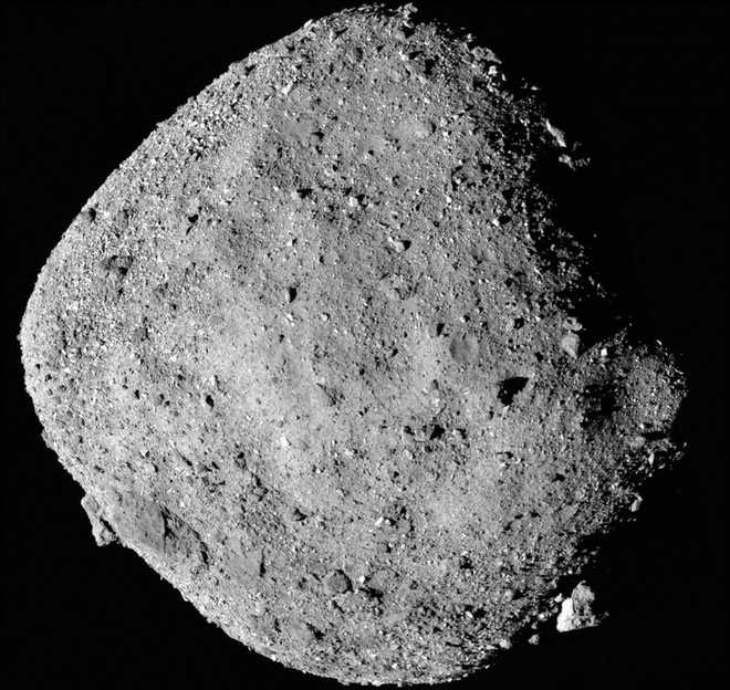 NASA''s asteroid sampling probe snaps picture of Earth