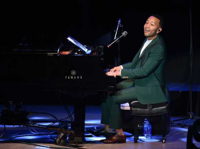 John Legend is learning to swim at 40