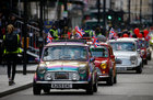 Morris Mini cars ride during the New Year's Day parade in London, Britain, January 1. Reuters