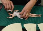 Stylist Carlyle Nuera works on fashion for Barbie doll prototypes at a workshop in the Mattel design center as the iconic doll turns 60, in El Segundo, on December 7, 2018. — AFP