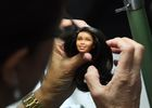 A designer adds hair to a Barbie doll prototype at a workshop in the Mattel design center as the iconic doll turns 60, in El Segundo, on December 7, 2018 — AFP